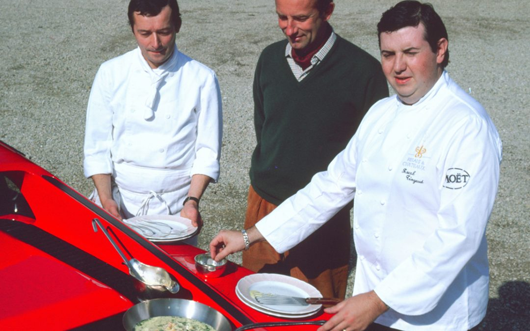 1986 – Pascal Tingaud, starred chef of the Auberge de Condé in La Ferté-sous-Jouarre, cooking a fillet of salmon with sorrel sauce on the grille of my Ferrari Testarossa perfectly warmed up after a stint at almost 300 km/h
