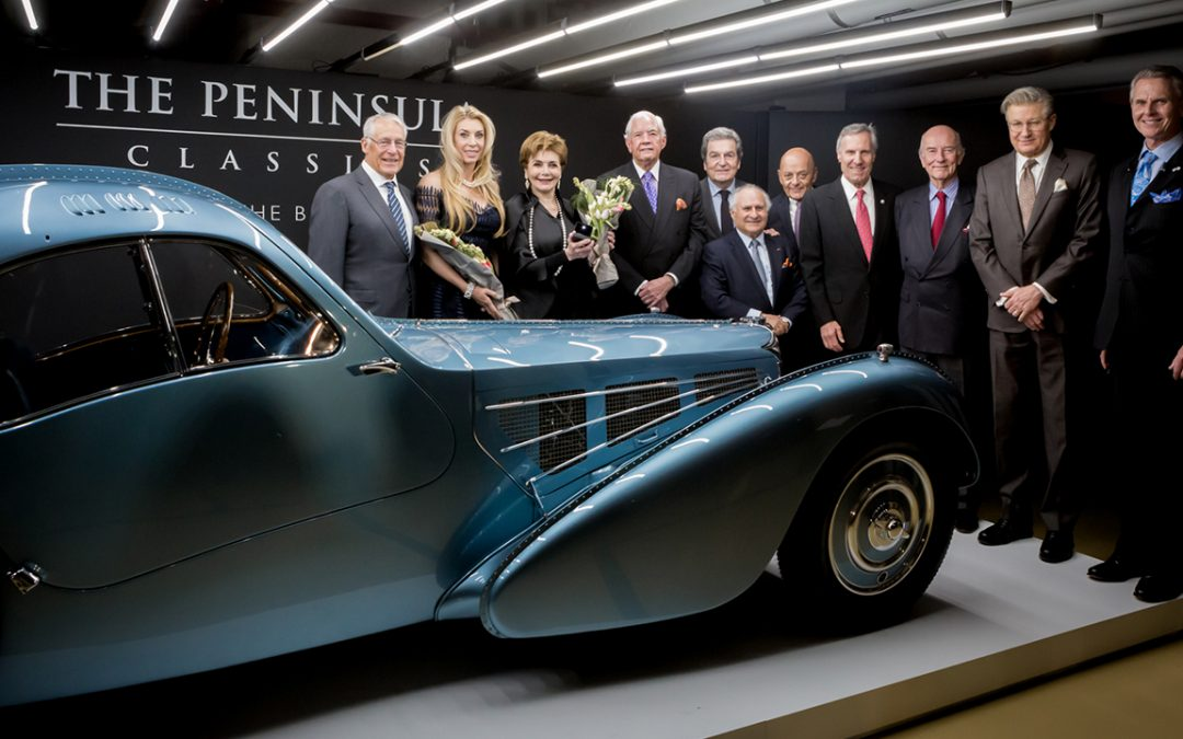 2018.02.09 - Rob and Melani Walton with Merle and Peter Mullin (from left to right) who share the ownership of the 1936 Bugatti 57SC Atlantic, winner of the third Peninsula Classics Best of the Best Award
